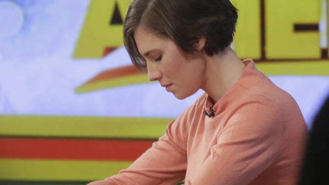 "Amanda Knox bows her head during a television interview, Friday, Jan. 31, 2014 in New York. Knox said she will fight the reinstated guilty verdict against her and an ex-boyfriend in the 2007 slaying of a British roommate in Italy and vowed to ""never go willingly"" to face her fate in that country's judicial system . ""I'm going to fight this to the very end,"" she said in an interview with Robin Roberts on ABC's ""Good Morning America."" (AP Photo/Mark Lennihan)"