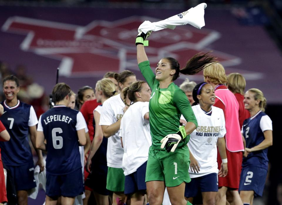 United States' Hope Solo (1) celebrates with teammates after winning the women's soccer gold medal match against Japan at the 2012 Summer Olympics, Thursday, Aug. 9, 2012, in London. (AP Photo/Ben Curtis)