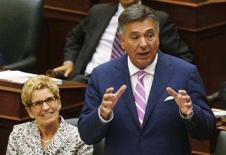 Ontario Finance Minister Sousa delivers the provincial budget alongside Ontario Premier Wynne at Queens Park in Toronto