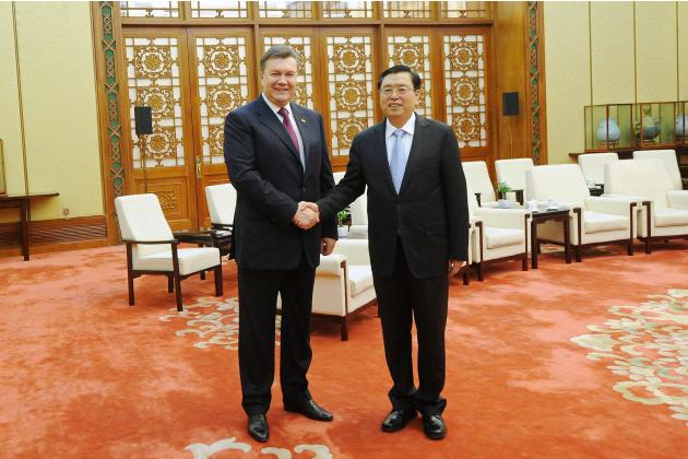 Ukraine's President Yanukovich shakes hands with Chinese Chairman of the National People's Congress Zhang in Beijing