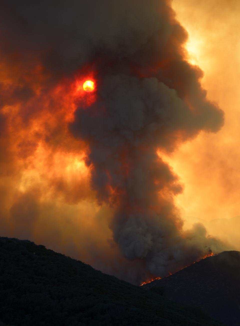 Smoke billows from a fire burring in Point Mugu State Park during a wildfire that burned several thousand acres, Thursday, May 2, 2013, in Ventura County, Calif.   (AP Photo/Mark J. Terrill)