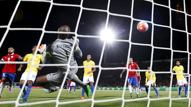 Brazil's goalkeeper Jefferson fails to stop a goal scored by Vargas of Chile during their 2018 World Cup qualifying soccer match in Santiago
