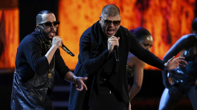 "Yandel performs ""Plakito"" with Farruko at the 15th Annual Latin Grammy Awards in Las Vegas"