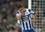 Deportivo forward Riki celebrates after scoring during their Spanish League match against Real Madrid on September 30. The ball was played into Riki who found plenty of space between Raphael Varane and Pepe and then slotted into the corner