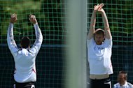 Miroslav Klose (left) and Per Mertesacker warm up during a Germany training session near the Dwor Oliwski hotel in Gdansk on June 19, 2012