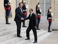 French President Francois Hollande (L) welcomes Myanmar President Thein Sein on his arrival for a meeting at the Elysee presidential palace in Paris on July 17, 2013. Hollande urged Thein Sein to push ahead with reforms and follow through on a vow to release political prisoners, as the two met in Paris