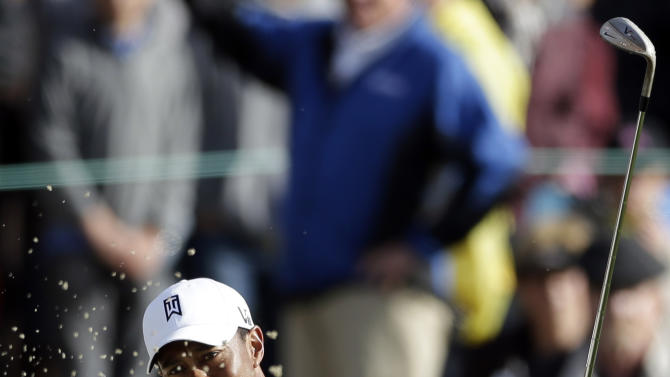 Tiger Woods hits out of a bunker on the 18th hole during the third round of the Farmers Insurance Open golf tournament at the Torrey Pines Golf Course, Sunday, Jan. 27, 2013, in San Diego. (AP Photo/Gregory Bull)
