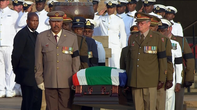 Still image from SABC video shows the coffin of former South African President Nelson Mandela being carried by military personnel at the Union Buildings in Pretoria