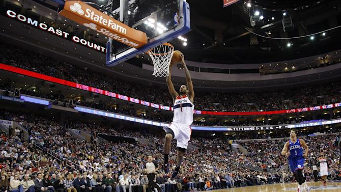 Washington Wizards' Trevor Ariza goes up for a dunk during the first half of an NBA basketball game against the Philadelphia 76ers, Saturday, March 1, 2014, in Philadelphia. (AP Photo/Matt Slocum)