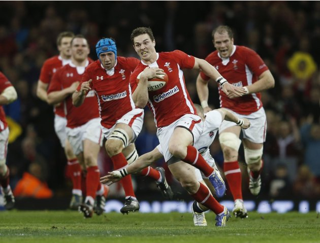 Wales' North runs with the ball during their Six Nations international rugby union match against England at the Millennium Stadium in Cardiff