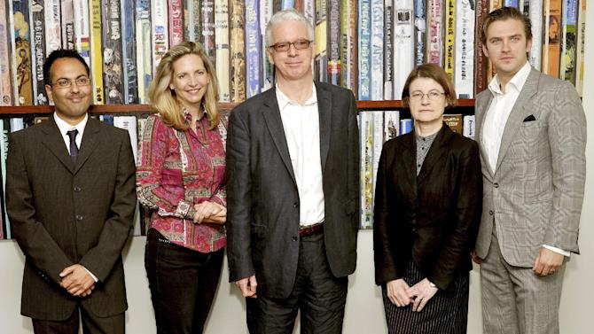 The Judges for the Man Booker prize for fiction, left-right,  Bharat Tandon, Amanda Foreman, Sir Peter Stothard (Chairman), Dinah Birch and Dan Stevens, at a Press conference Tuesday Sept. 11, 2012, in London, to name the six short-listed books for the annual award, to be held at the Guildhall in the City of London on upcoming October 16. The literary prize, which brings a big boost in publicity and sales for the winner, is open to writers from Britain, Ireland and the Commonwealth of former British colonies.  (AP Photo / John Stillwell, PA) UNITED KINGDOM OUT - NO SALES - NO ARCHIVES