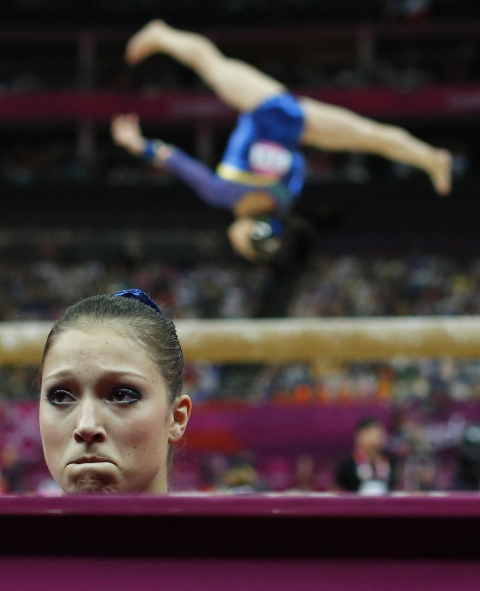 Brazilian gymnast Ethiene Cristina Gonser Franco reacts after her performance on the balance beam during the artistic gymnastics women's qualifications at the 2012 Summer Olympics, Sunday, July 29, 2012, in London. (AP Photo/Matt Dunham)