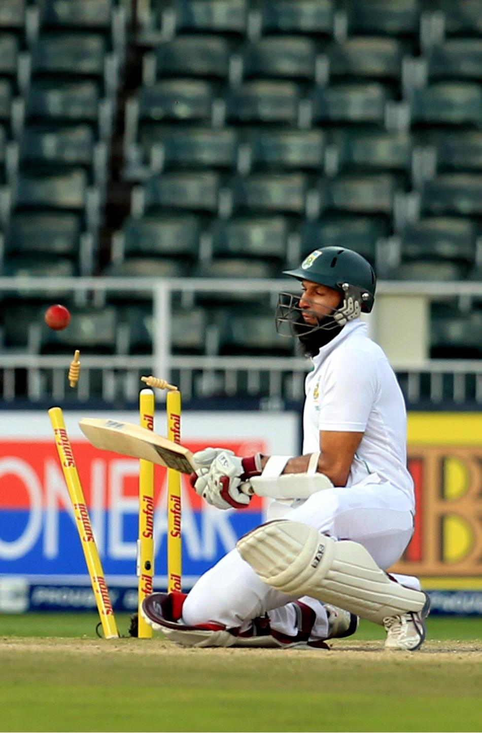 South African player Hashim Amla after bowled by Mohammed Shami during the 4th day of 1st Test match between India and South Africa at Wanderers in Johannesburg on Dec. 21, 2013. (Photo: IANS)