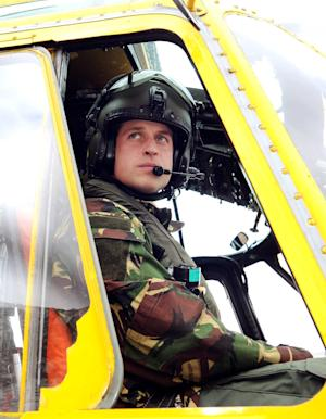 "FILE - In this March 31, 2011 file photo, Britain's Prince William, the Duke of Cambridge and a Royal Air Force helicopter pilot, sits at the controls of a Sea King helicopter. Prince William will be deployed to the politically sensitive Falkland Islands in 2012 as an air force search and rescue pilot, according to Britain's defense ministry. Prince William's deployment is a sore point for Argentina, whose foreign ministry complained on Tuesday Jan. 31, 2012 that the royal ""will arrive on our soil in the uniform of a conquistador, and not with the wisdom of a statesman who works for peace and dialogue between nations,"" after Britain announced that it is sending an advanced warship to the disputed South Atlantic archipelago, which Argentina claims as the Malvinas Islands.  (AP Photo/John Stillwell/PA, File) UNITED KINGDOM OUT"