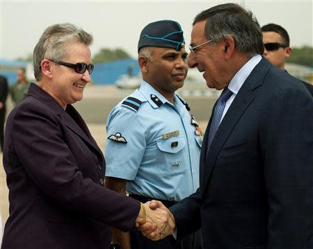 U.S. Defense Secretary Leon Panetta shakes hands with U.S. ambassador to India Nancy Powell upon his arrival in New Delhi
