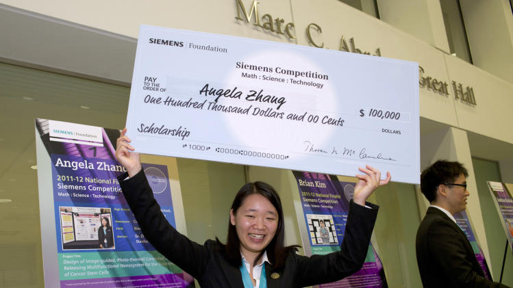 This handout photo provided by Siemens Foundation shows Angela Zhang, 17, of Cupertino, Calif., who won top individual honors at the Siemens Foundation's annual high school science competition, which announced winners in Washington, Monday, Dec. 5, 2011. (AP Photo/Siemens Foundation)