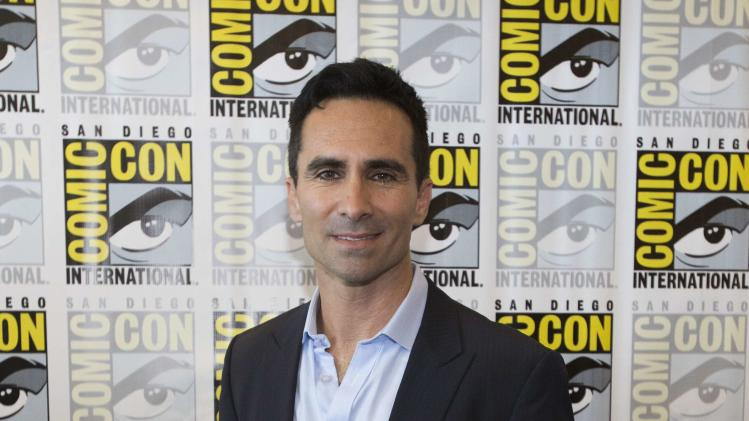 "Cast member Carbonell poses at a press line for ""Bates Motel"" during the 2014 Comic-Con International Convention in San Diego"