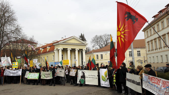 Lithuanians gather for an anti-American demonstration rally at the President palace, in Vilnius, Lithuania, Tuesday, Feb. 26, 2013. Protesters oppose government plans to explore shale gas fields in the western part of the country. (AP Photo/Mindaugas Kulbis)