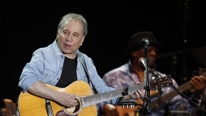 In this July 17, 2011 photo, singer and songwriter Paul Simon performs during a concert at the Arena Civica in Milan, Italy. Paul Simon probably never had a vocal partner quite like Bobby McFerrin, who coaxed him onstage for an impromptu performance of a Simon and Garfunkel hit _ the highlight of opening night of Jazz at Lincoln Center's 25th anniversary season, Friday, Sept. 14, 2012 in New York.  (AP Photo/Luca Bruno)