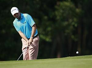 Aiken from South Africa chips a shot during HSBC Champions at Mission Hills in Dongguan