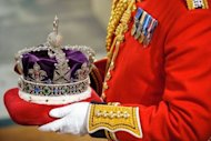 The Imperial State Crown is carried on a cushion to be presented to Britain's Queen Elizabeth II in the Palace of Westminster during the State Opening of Parliament in London. Queen Elizabeth II voiced the ruling coalition's bid to offer economic hope and win back voters after its worst few weeks yet in her annual address to the British parliament Wednesday