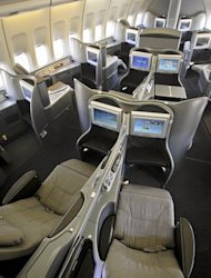 This Oct. 28, 2011 photo shows the new first class interior section of a United Airlines 747 plane at San Francisco International Airport in San Francisco. U.S. airlines are spending nearly $2 billion to upgrade long-neglected lounges and aircraft. Their most-prized customers are getting new seats that turn into beds, large flat-screen TVs and savory food and wine. (AP Photo/Tony Avelar)