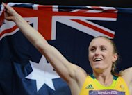 Australia's Sally Pearson celebrates with her national flag after winning the women's 100m hurdles final at the athletics event during the London 2012 Olympic Games in London