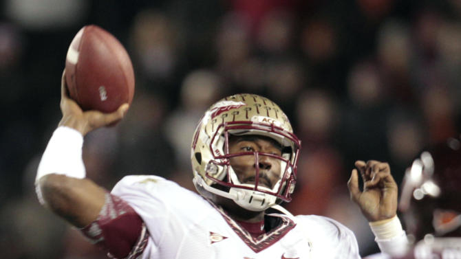 Florida State quarterback EJ Manuel passes during the first half of an NCAA college football game against Virginia Tech in Blacksburg, Va., Thursday, Nov. 8, 2012. (AP Photo/Steve Helber)