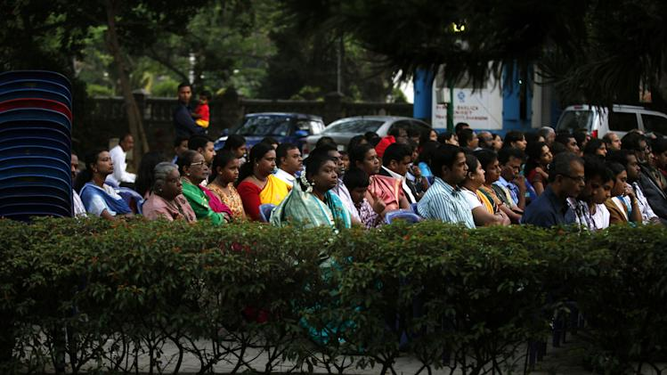 Indian Christians attend an early morning Easter Mass in Bangalore, India, Sunday, March 31, 2013.  (AP Photo/Aijaz Rahi)