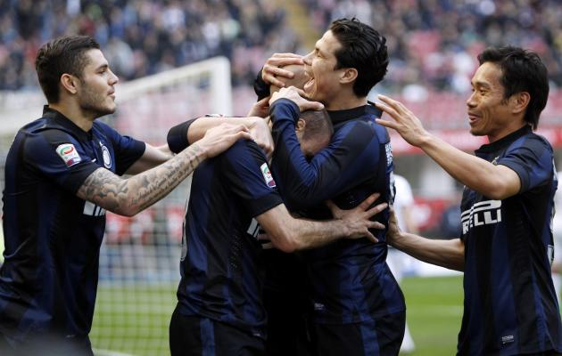 Inter Milan's Palacio celebrates with teammates after scoring against Torino during their Italian Serie A soccer match in Milan