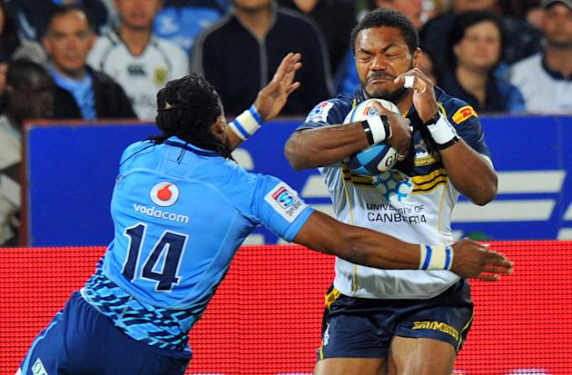 Australia's ACT Brumbies winger Henry Speight (R) vies with a South-Africa's Northern Bulls' player during the Super 15 Rugby union match between Northern Bulls and ACT Brumbies at the Loftus Versfeld