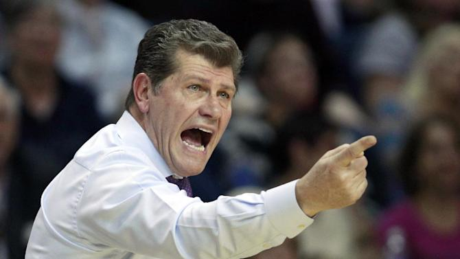 Connecticut head coach Geno Auriemma calls to his players during the first half of a women's NCAA college regional semifinal basketball game against Maryland in Bridgeport, Conn., Saturday, March 30, 2013. (AP Photo/Charles Krupa)
