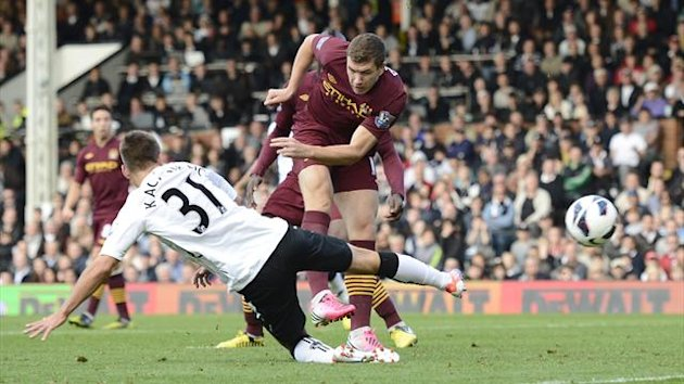 Manchester City's Edin Dzeko scores with his first touch against Fulham in the Premier League, September 2012