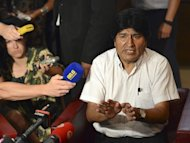 "Bolivian President Evo Morales talks to journalists on July 3, 2013 at the airport of Schwechat, near Vienna. Morales urged European countries to ""free themselves from the US empire"" as he arrived home after his plane was diverted because of suspicions US intelligence leaker Edward Snowden was traveling with him"