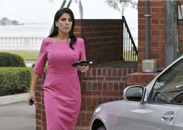 Jill Kelley leaves her home Tuesday, Nov 13, 2012 in Tampa, Fla. Kelley is identified as the woman who allegedly received harassing emails from Gen. David Petraeus' paramour, Paula Broadwell. She serv