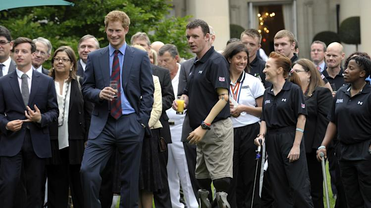 Britain's Prince Harry listens to remarks during a reception with wounded soldiers at the British Ambassador's Residence in Washington to meet members of the British and American teams who are taking part in the Warrior Games, Monday, May 7, 2012. The Warrior Games is an event hosted every year by the U.S. Olympic Committee. (AP Photo/Susan Walsh, Pool)