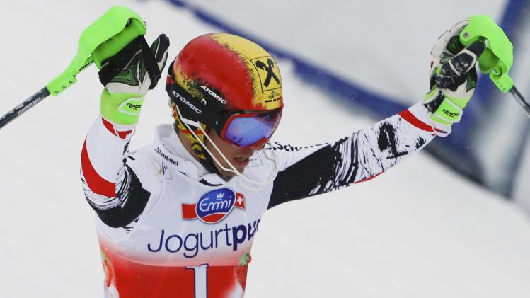 Hirscher of Austria reacts in the finish area during the first run of the men's slalom competition at the FIS Alpine Skiing World Cup Finals in Lenzerheide
