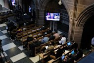 British Prime Minister David Cameron&#39;s statement is watched on a television screen in Liverpool&#39;s Anglican Cathedral, on September 12, 2012, during a press conference for the release of unpublished papers by the Hillsborough Independent Panel. Cameron apologised Wednesday to the families of the 96 victims of the 1989 Hillsborough football stadium disaster for the &quot;double injustice&quot; they suffered