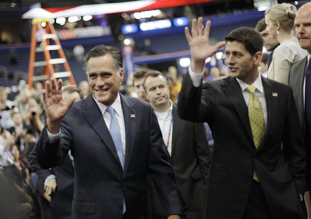 Republican presidential nominee Mitt Romney and his vice presidential running mate Rep. Paul Ryan, R-Wis. wave to their supporters after posing a group picture with their campaign staff at the Republican National Convention in Tampa, Fla., on Thursday, Aug. 30, 2012. (AP Photo/David Goldman)