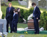 Robert F. Kennedy Jr., left, and his children turn away after paying their respects at the casket of Mary Richardson Kennedy, in St. Francis Xavier Cemetery in Centerville, Mass., Saturday, May 19, 2012. Mary Richardson Kennedy was found dead of an apparent suicide last week at her home in Bedford, N.Y. (AP Photo/Michael Dwyer)