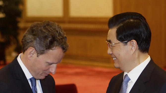 "U.S. Treasury Secretary Timothy Geithner, left, shakes hands with Chinese President Hu Jintao prior to a meeting at the Great Hall of the People in Beijing Friday, May 4, 2012. Geithner told Hu on Friday that China's moves toward a more market-oriented exchange rate are ""very promising"" and said economic relations are improving despite occasional tensions. (AP Photo/Jason Lee, Pool)"