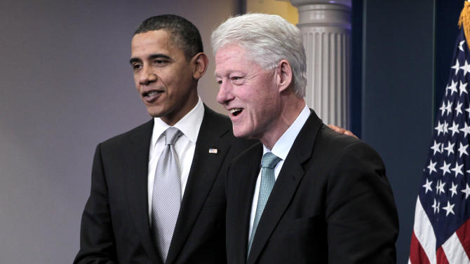 Former President Bill Clinton joins President Barack Obama in the White House briefing room in Washington, Friday, Dec. 10, 2010, to talk about Obama's urging of the Congress to move on the tax compromise he made with Republican congressional leaders. (AP Photo/J. Scott Applewhite)