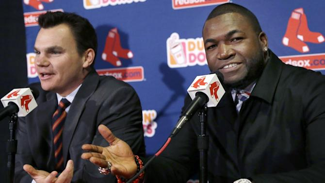 Boston Red Sox's David Ortiz, right, and general manager Ben Cherington react during a baseball news conference, Monday, Nov. 5, 2012, at Fenway Park in Boston. Ortiz announced that he has finalized a $26 million, two-year contract, which includes bonuses that could raise the value to $30 million. (AP Photo/Elise Amendola)