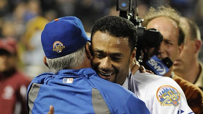 New York Mets starting pitcher Johan Santana, right, hugs manager Terry Collins after throwing a no-hitter against the St. Louis Cardinals in a baseball game on Friday, June 1, 2012, at Citi Field in New York. The Mets won 8-0. (AP Photo/Kathy Kmonicek)