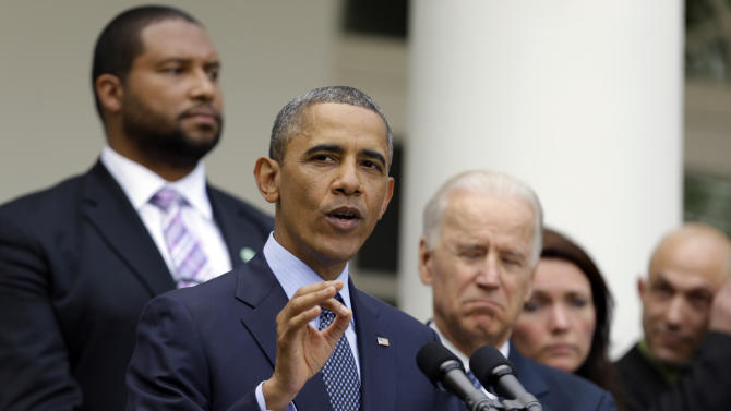 President Barack Obama gestures next to Vice President Joe Biden, as he speaks during a news conference in the Rose Garden of the White House, in Washington, on Wednesday, April 17, 2013, about the defeat in the Senate of a bill to expand background checks on guns. He is joined by Newtown family members from left, Jimmy Greene, father of Ana; Nicole Hockley, mother of Dylan; and Jeremy Richman, father of Avielle. (AP Photo/Manuel Balce Ceneta)
