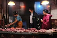 <p>Shoppers buy pork at a market in Hefei, China's Anhui province. China's industrial output growth weakened in August to its slowest pace in more than three years, official figures showed, confirming a deepening slowdown in the world's second-biggest economy.</p>