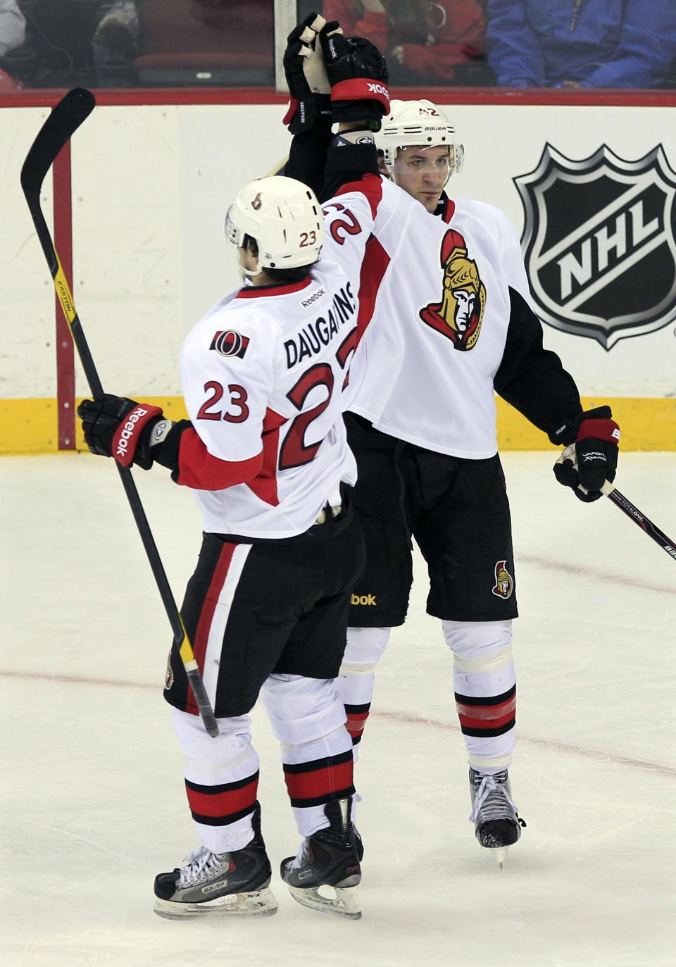 Ottawa Senators' Kaspars Daugavins (23), of Latvia, celebrates a goal by Jim O'Brien, right, during the second period of an NHL hockey game against the New Jersey Devils in Newark, N.J., Saturday, April 7, 2012. (AP Photo/Mel Evans)