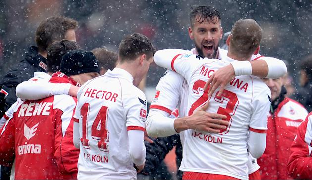 Stefan Maierhofer of Cologne celebrates with teammate Kevin McKenna after the Second Bundesliga match between 1. FC Koeln and Union Berlin at RheinEnergieStadion on February 23, 2013 in Cologne, Germa