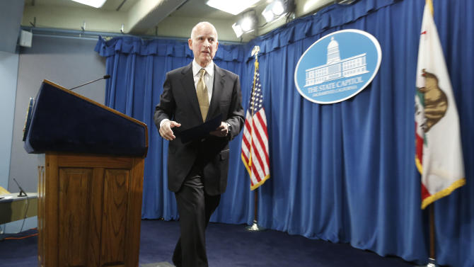 Gov. Jerry Brown leaves a news conference, where he called for federal judges to return control of California prisons to the state, at the Capitol in Sacramento, Calif., Tuesday, Jan. 8, 2013.   Brown  said that it is too dangerous for the state to further reduce its prison population as required by a federal court order. (Photo/Rich Pedroncelli)