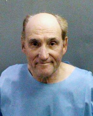 This photo released Tue. Jan. 29, 2013 by the Orange County Sheriff's Department showing Stanwood Fred Elkus, 75, of Lake Elsinore who was arrested Monday, Jan. 28,2013, suspected of killing Dr. Ronald Franklin Gilbert, 52, of Huntington Beach at the medical office in Orange County on Monday Jan. 28,2013. (AP Photo/Orange County Sheriff's Department)